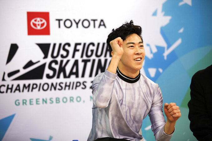 FILE - Nathan Chen reacts to his score in the men's short program at the U.S. Figure Skating Championships, in Greensboro, N.C., in this Saturday, Jan. 25, 2020, file photo. The U.S. Figure Skating Championships are being moved from San Jose, California to Las Vegas. The national federation said Monday, Nov. 9, 2020, the switch was based partly on the successful bubble environment used for Skate America last month at the Orleans Arena in Las Vegas. San Jose will now get the 2023 nationals, while the 2022 event, which serves as the Olympic trials, will be in Nashville. Nationals will take place Jan. 11-21 in Las Vegas. (AP Photo/Lynn Hey, File)