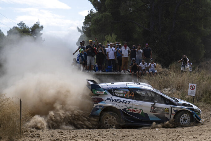 Gus Greensmith from Britain and his co driver Chris Patterson with their Ford Fiesta WRC car compete in the WRC Acropolis Rally at the stage of Aghii Theodori, west of Athens, on Friday, Sept. 10, 2021. The World Rally Championship returned to Greece after an eight-year absence. (AP Photo/Petros Giannakouris)