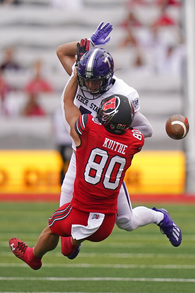 Weber State safety Preston Smith, rear, interferes with a pass to Utah tight end Brant Kuithe (80) during the first half of an NCAA college football game Thursday, Sept. 2, 2021, in Salt Lake City. (AP Photo/Rick Bowmer)