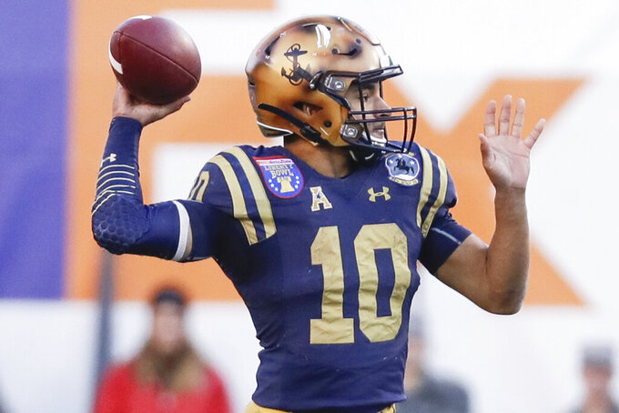 Navy quarterback Malcolm Perry passes against Kansas State in the first half of the Liberty Bowl NCAA college football game Tuesday, Dec. 31, 2019, in Memphis, Tenn. (AP Photo/Mark Humphrey)