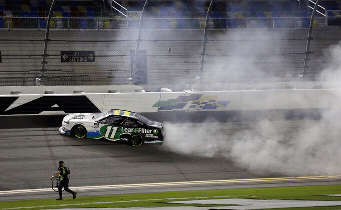 Justin Haley does a burnout after winning a NASCAR Xfinity auto race at Daytona International Speedway, Friday, Aug. 28, 2020, in Daytona Beach, Fla. (AP Photo/Terry Renna)