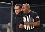 Duke coach Mike Krzyzewski confers with a referee during the first half of the team's NCAA college basketball game against Georgia Tech on Tuesday, March 2, 2021, in Atlanta. (Hyosub Shin/Atlanta Journal-Constitution via AP)