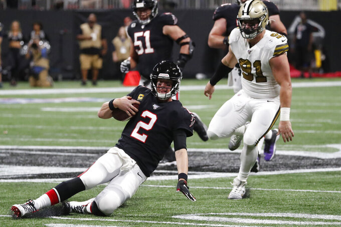 Atlanta Falcons quarterback Matt Ryan (2) slides to the turf after during the first half of an NFL football game against the New Orleans Saints, Thursday, Nov. 28, 2019, in Atlanta. (AP Photo/John Bazemore)