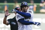Milwaukee Brewers' Eduardo Escobar reacts after hitting an RBI double during the fifth inning of a baseball game against the Chicago Cubs Sunday, Sept. 19, 2021, in Milwaukee. (AP Photo/Morry Gash)