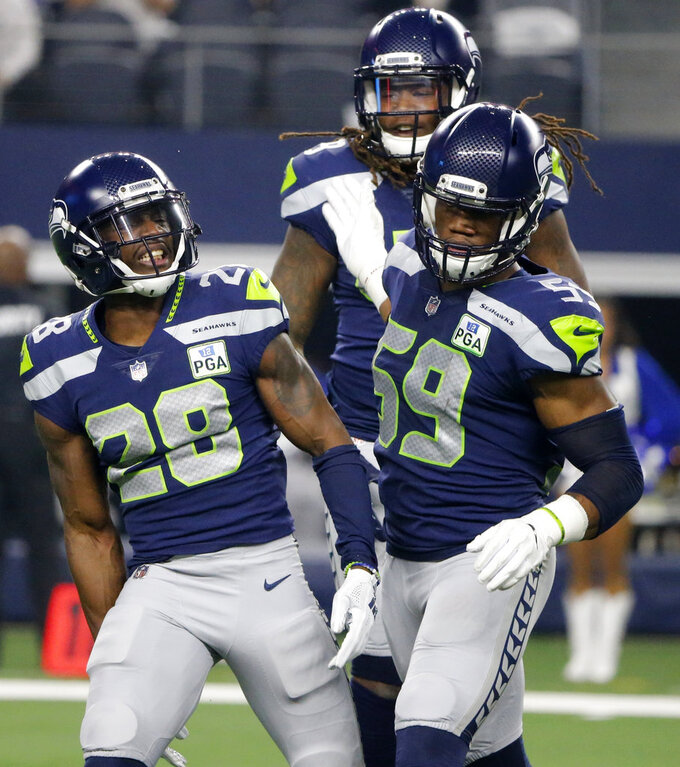 Seattle Seahawks specials teams celebrates a tackle on a punt return by the Dallas Cowboys during the first half of the NFC wild-card NFL football game in Arlington, Texas, Saturday, Jan. 5, 2019. (AP Photo/Michael Ainsworth)