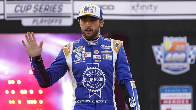 Chase Elliott waves to the crowd during driver introductions prior to the start of the NASCAR Cup series auto race in Richmond, Va., Saturday, Sept. 11, 2021. (AP Photo/Steve Helber)