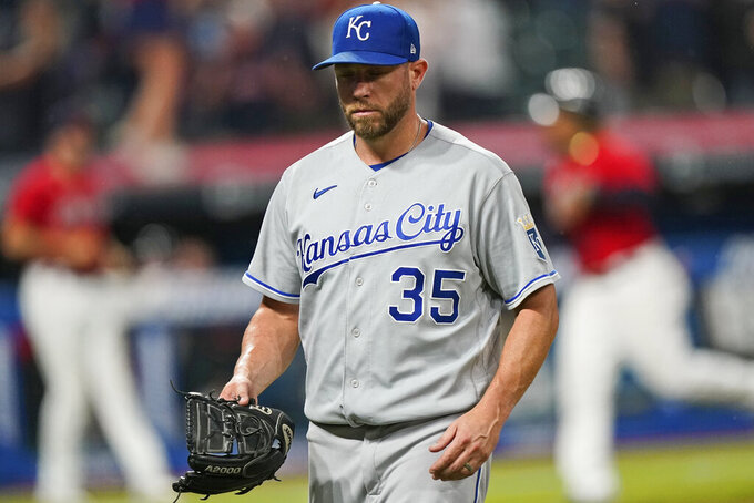 Kansas City Royals relief pitcher Greg Holland walks off the field after giving up a three-run home run to Cleveland Indians' Franmil Reyes during the ninth inning of a baseball game Thursday, July 8, 2021, in Cleveland. The Indians won 7-4. (AP Photo/Tony Dejak)