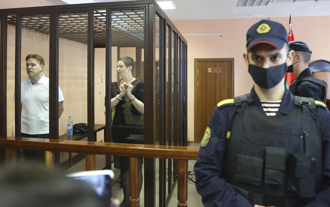 Belarus' opposition activists Maria Kolesnikova, right, and Maxim Znak attend a court hearing in Minsk, Belarus, Monday, Sept. 6, 2021. A court in Belarus on Monday sentenced two leading opposition activists to lengthy prison terms, the latest move in the relentless crackdown Belarusian authorities unleashed on dissent in the wake of last year's months-long anti-government protests. Maria Kolesnikova, a top member of the opposition Coordination Council, has been in custody since her arrest last September. A court in Minsk found her guilty of conspiring to seize power, creating an extremist organization and calling for actions damaging state security and sentenced her to 11 years in prison. Znak was sentenced to 10 years in prison. (Ramil Nasibulin/BelTA pool photo via AP)