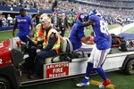 Emergency personnel cart New York Giants quarterback Daniel Jones is carted off as wide receiver Kadarius Toney (89) walks alongside talking with Jones in the first half of an NFL football game against the Dallas Cowboys in Arlington, Texas, Sunday, Oct. 10, 2021. (AP Photo/Michael Ainsworth)