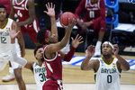 Arkansas guard JD Notae, center, shoots over Baylor guard MaCio Teague (31) and forward Flo Thamba (0) during the second half of an Elite 8 game in the NCAA men's college basketball tournament at Lucas Oil Stadium, Monday, March 29, 2021, in Indianapolis. (AP Photo/Darron Cummings)