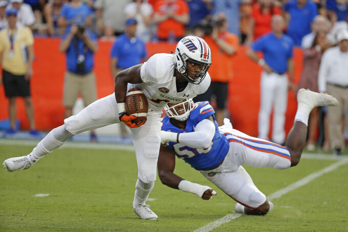 UT Martin wide receiver Jaylon Moore, left, tries to get around Florida linebacker Jonathan Greenard during the first half of an NCAA college football game, Saturday, Sept. 7, 2019, in Gainesville, Fla. (AP Photo/John Raoux)