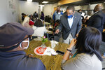 Virginia Democratic gubernatorial candidate Lt. Gov. Justin Fairfax, right, speaks to supporters at Pink Fish restaurant in Hampton, Va., Thursday, April 8, 2021. Fairfax has long had lofty political ambitions, and despite facing two unresolved allegations of sexual assault he's pressing forward with a bid for governor. (AP Photo/Steve Helber)