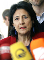 FILE In this file photo taken on Sunday, Oct. 28, 2018, Salome Zurabishvili speaks to the media at a polling station during the presidential election in Tbilisi, Georgia.  During an interview Thursday July 11, 2019, Zurabishvili said she'll