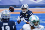 Nevada tight end Cole Turner (19) keeps his eyes on the ball for a pass reception against Tulane during the first half of the Idaho Potato Bowl NCAA college football game, Tuesday, Dec. 22, 2020, in Boise, Idaho. (AP Photo/Steve Conner)