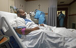 Cedric Daniels, 37, of Gonzales, La., rests in his room, recovering from COVID-19 at Our Lady of the Lake Regional Medical Center in Baton Rouge, Monday, Aug. 2, 2021. Louisiana is leading the nation in the number of new COVID cases per capita and remains one of the bottom five states in administering vaccinations.  (AP Photo/Ted Jackson)