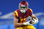 FILE - In this Dec 12, 2020, file photo, Southern California wide receiver Drake London (15) runs the ball during the second half of an NCAA football game against UCLA in Pasadena, Calif. (AP Photo/Ashley Landis, File)