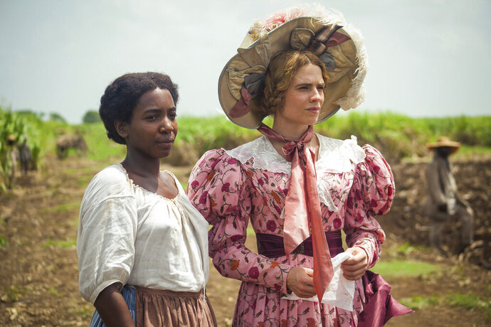 This image released by PBS shows Tamara Lawrance, left, and Hayley Atwell in a scene from the miniseries