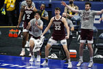 Mississippi State players celebrate on the bench after a score against Kentucky in the first half of an NCAA college basketball game in the Southeastern Conference tournament, Thursday, March 11, 2021, in Nashville, Tenn. (AP Photo/Mark Humphrey)