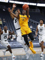Wyoming's A.J. Banks (2) shoots around Colorado's D'Shawn Schwartz (5) during the first half on an NCAA college basketball game Sunday, Nov. 24, 2019, in Las Vegas. (AP Photo/John Locher)