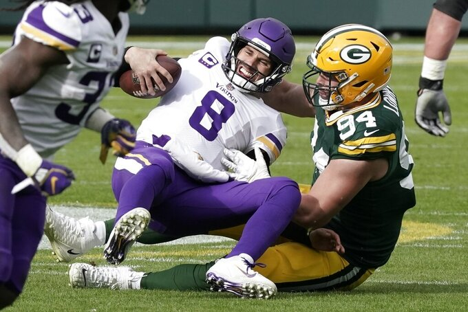 Green Bay Packers' Dean Lowry sacks Minnesota Vikings' Kirk Cousins during the first half of an NFL football game Sunday, Nov. 1, 2020, in Green Bay, Wis. (AP Photo/Morry Gash)