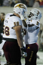 Arizona State's Eno Benjamin, right, celebrates with Alex Losoya (56) after scoring a touchdown against California in the first half of an NCAA college football game, Friday, Sept. 27, 2019, in Berkeley, Calif. (AP Photo/Ben Margot)