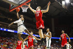 Michigan State forward Aaron Henry, left, drives to the basket ahead of Bradley forward Luuk van Bree (13) during a first round men's college basketball game in the NCAA Tournament, Thursday, March 21, 2019, in Des Moines, Iowa. (AP Photo/Charlie Neibergall)
