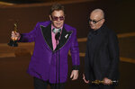 Elton John, left, and Bernie Taupin accept the award for best original song for