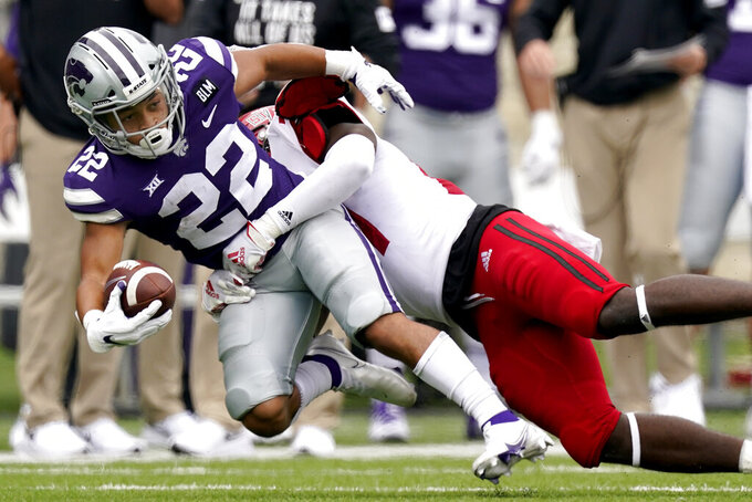 Kansas State running back Deuce Vaughn (22) is tackled by Arkansas State linebacker Fred Hervey, right, during the second half of an NCAA college football game Saturday, Sept. 12, 2020, in Manhattan, Kan. (AP Photo/Charlie Riedel)