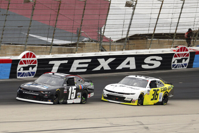 NASCAR Xfinity Series driver Matt Mills (5) and driver Alex Labbe (36) come out of turn four onto the front stretch during a NASCAR Xfinity Series auto race at Texas Motor Speedway in Fort Worth, Texas, Saturday Oct. 24, 2020. (AP Photo/Richard W. Rodriguez)