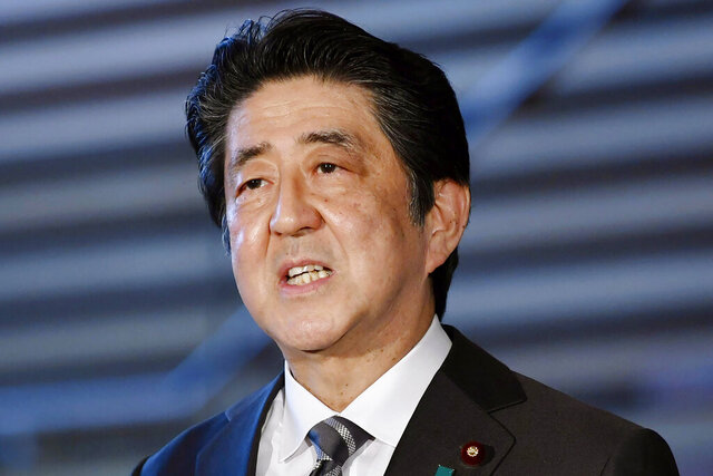 Japanese Prime Minister Shinzo Abe speaks to reporters at his official residence in Tokyo Friday, May 1, 2020. Abe told reporters Friday that the coronavirus state of emergency that is supposed to end next week will have to be kept in place roughly for another month. (Kyodo News via AP)