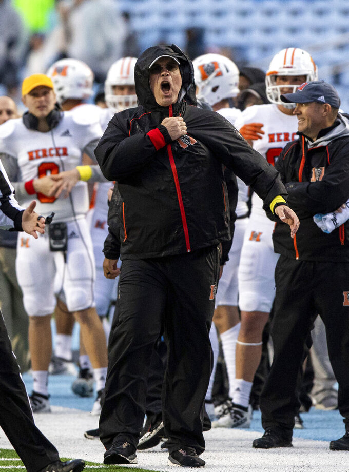 Mercer head coach Bobby Lamb shouts at an official after a play during the first half of an NCAA college football game against North Carolina in Chapel Hill, N.C., Saturday, Nov. 23, 2019. (AP Photo/Ben McKeown)