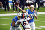 Los Angeles Chargers quarterback Justin Herbert (10) throws against the Denver Broncos during the first half of an NFL football game Sunday, Dec. 27, 2020, in Inglewood, Calif. (AP Photo/Kelvin Kuo)