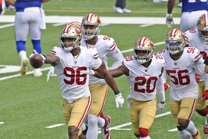 San Francisco 49ers' Dion Jordan (96) celebrates a turnover with teammates during the first half of an NFL football game against the New York Giants, Sunday, Sept. 27, 2020, in East Rutherford, N.J. (AP Photo/Bill Kostroun)
