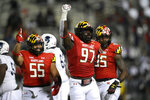 Maryland defensive lineman Sam Okuayinonu (97) reacts after he made a tackle during the first half of an NCAA college football game against Howard, Saturday, Sept. 11, 2021, in College Park, Md. Maryland defensive linemen Ami Finau (55) and Lawtez Rogers, right, look on. (AP Photo/Nick Wass)