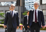 Former Nissan chairman Carlos Ghosn, left, accompanied by his lawyer Junichiro Hironaka, arrives at Tokyo District Court for a pre-trial meeting in Tokyo Thursday, May 23, 2019. Ghosn, who is out on bail, has been charged with under-reporting his post-retirement compensation and breach of trust in diverting Nissan money and allegedly having it shoulder his personal investment losses., lawyer of (Ren Onuma//Kyodo News via AP)