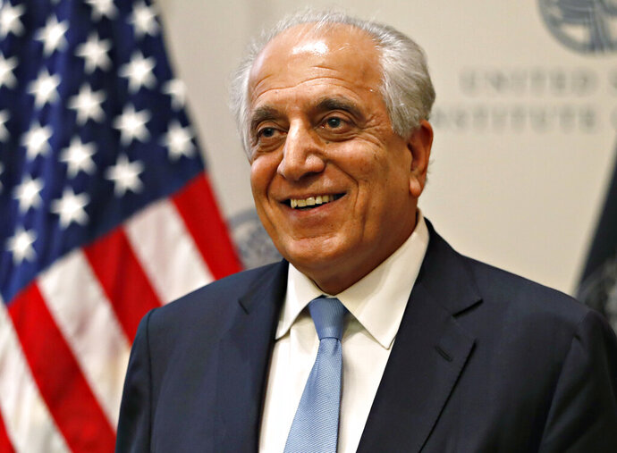 FILE - In this Feb. 8, 2019, file photo, Special Representative for Afghanistan Reconciliation Zalmay Khalilzad at the U.S. Institute of Peace, in Washington.  Representatives of Russia, China, the United States and Pakistan have agreed that negotiation is the only road to peace in Afghanistan, including an early resumption of direct U.S. talks with the Taliban. In a statement released at the end of meetings in Moscow on Friday, Oct. 25, China, Russia and Pakistan called on Washington to return to the negotiation table with the Taliban and sign an agreement that will set the stage for Afghans on both sides of the protracted conflict to start face-to-face discussions on what a post-war Afghanistan would look like.  Khalilzad had a preliminary peace deal with the Taliban until President Donald Trump in September declared the talks dead after a series of attacks killed several people, including a U.S. soldier. (AP Photo/Jacquelyn Martin, File)