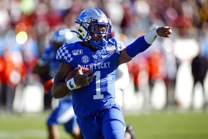 Kentucky quarterback Lynn Bowden Jr. (1) celebrates as he runs 25-yards for a touchdown against Virginia Tech in the first half of the Belk Bowl NCAA college football game in Charlotte, N.C., Tuesday, Dec. 31, 2019. (AP Photo/Nell Redmond)