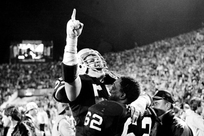FILE - In this Jan. 23, 1984, file photo, Los Angeles Raiders' Matt Millen gestures as he celebrates with teammate Reggie Kinlaw following the Raiders' 38-9 win over the Washington Redskins in Super Bowl XVIII in Tampa. (AP Photo/File)