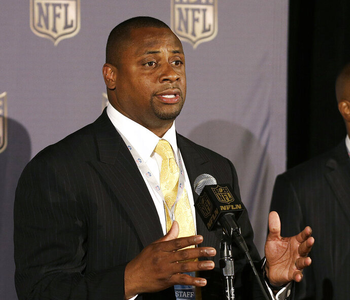 FILE - In this May 19, 2015, file photo, Troy Vincent, executive vice president of football operations for the NFL, speaks at the league's spring meetings in San Francisco. Vincent was instrumental in launching an initiative four years ago to help former players stay connected with their teams and to offer them assistance in many areas from making sure they get health checks to life after football. The NFL Legends Community now has a community director for each team, giving 20,000 former players a direct link to get involved and utilize the various offerings. (AP Photo/Jeff Chiu, File)