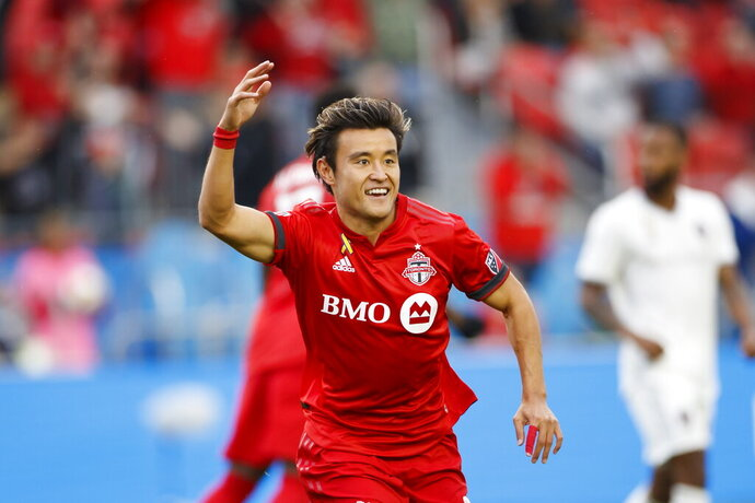 Toronto FC forward Tsubasa Endoh (31) celebrates a goal in the first half of MLS action against the Colorado Rapids at BMO Field in Toronto, Sunday, Sept. 15 2019. (Cole Burston/The Canadian Press via AP)
