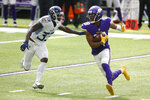 Minnesota Vikings wide receiver Justin Jefferson runs from Tennessee Titans cornerback Johnathan Joseph (33) after making a reception during the first half of an NFL football game, Sunday, Sept. 27, 2020, in Minneapolis. (AP Photo/Bruce Kluckhohn)