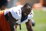 Denver Broncos defensive end Shelby Harris jokes with teammates as they take part in drills during NFL football training practice at the team's headquarters Wednesday, Aug. 25, 2021, in Englewood, Colo. (AP Photo/David Zalubowski)
