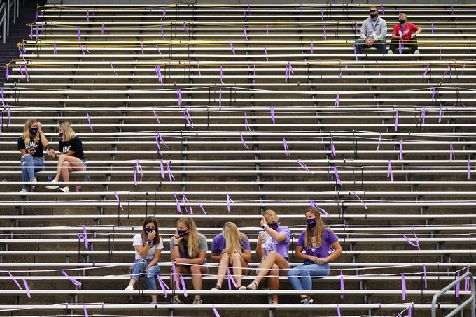 Fans are socially distanced as they watch the second half of an NCAA college football game between Kansas State and Arkansas State, Saturday, Sept. 12, 2020, in Manhattan, Kan. (AP Photo/Charlie Riedel)