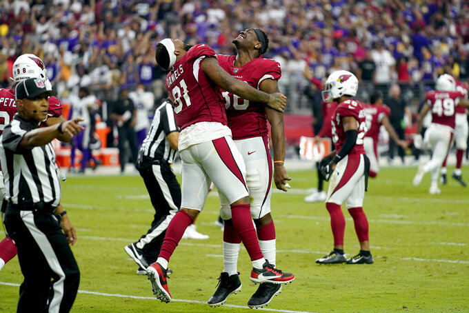 Arizona Cardinals tight end Darrell Daniels (81) and Arizona Cardinals safety James Wiggins celebrate after an NFL football game against the Minnesota Vikings, Sunday, Sept. 19, 2021, in Glendale, Ariz. The Cardinals won 34-33. (AP Photo/Ross D. Franklin)