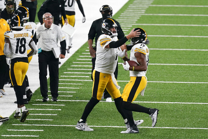 Pittsburgh Steelers quarterback Ben Roethlisberger (7) celebrates with wide receiver JuJu Smith-Schuster (19) after Smith-Schuster caught a touchdown pass against the New York Giants during the second quarter of an NFL football game Monday, Sept. 14, 2020, in East Rutherford, N.J. (AP Photo/Seth Wenig)