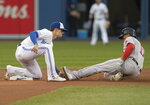 Boston Red Sox's Rafael Devers is tagged out by Toronto Blue Jays second baseman Cavan Biggio on an attempted steal during the first inning of a baseball game Tuesday, Sept. 10, 2019, in Toronto. (Fred Thornhill/The Canadian Press via AP)