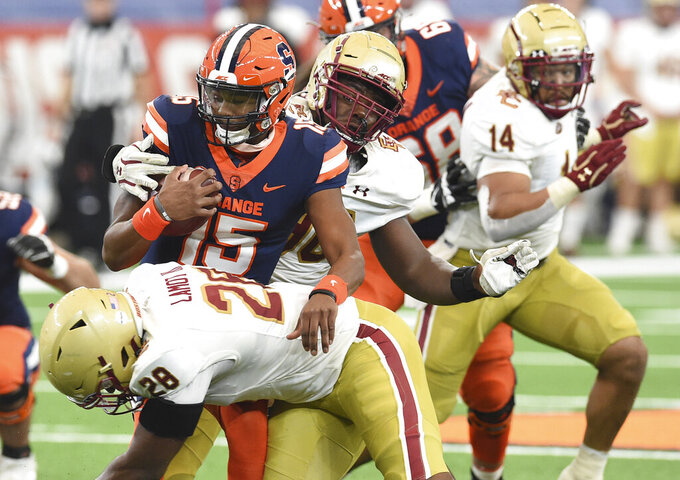 Syracuse quarterback JaCobian Morgan (15) is caught in the pocket by Boston College linebacker John Lamot (28) during the first half of NCAA college football game, Saturday, Nov. 7, 2020, at the Carrier Dome in Syracuse, N.Y. (Dennis Nett/The Post-Standard via AP)