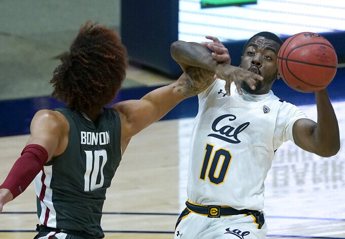 California guard Makale Foreman (10) is fouled by Washington State guard Isaac Bonton (10) during the first half of an NCAA college basketball game, Thursday, Jan. 7, 2021, in Berkeley, Calif. (AP Photo/Tony Avelar)