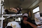 FILE -  In thos Oct. 8, 2016, file, photo, bodies of victims of a Saudi-led coalition airstrike are loaded in an ambulance, in Sanaa, Yemen. A database tracking violence said Wednesday, June 19, 2019 that at least 91,600 people have been killed in Yemen's civil war, presenting a new estimate after completing reporting for the first months of fighting in 2015. (AP Photo/Osamah Abdulrhman, File)
