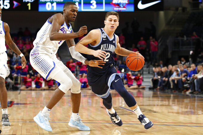 Villanova guard Collin Gillespie (2) gets past DePaul forward Paul Reed (4) during the first half of an NCAA college basketball game Wednesday, Feb. 19, 2020, in Chicago. (AP Photo/Jeff Haynes)